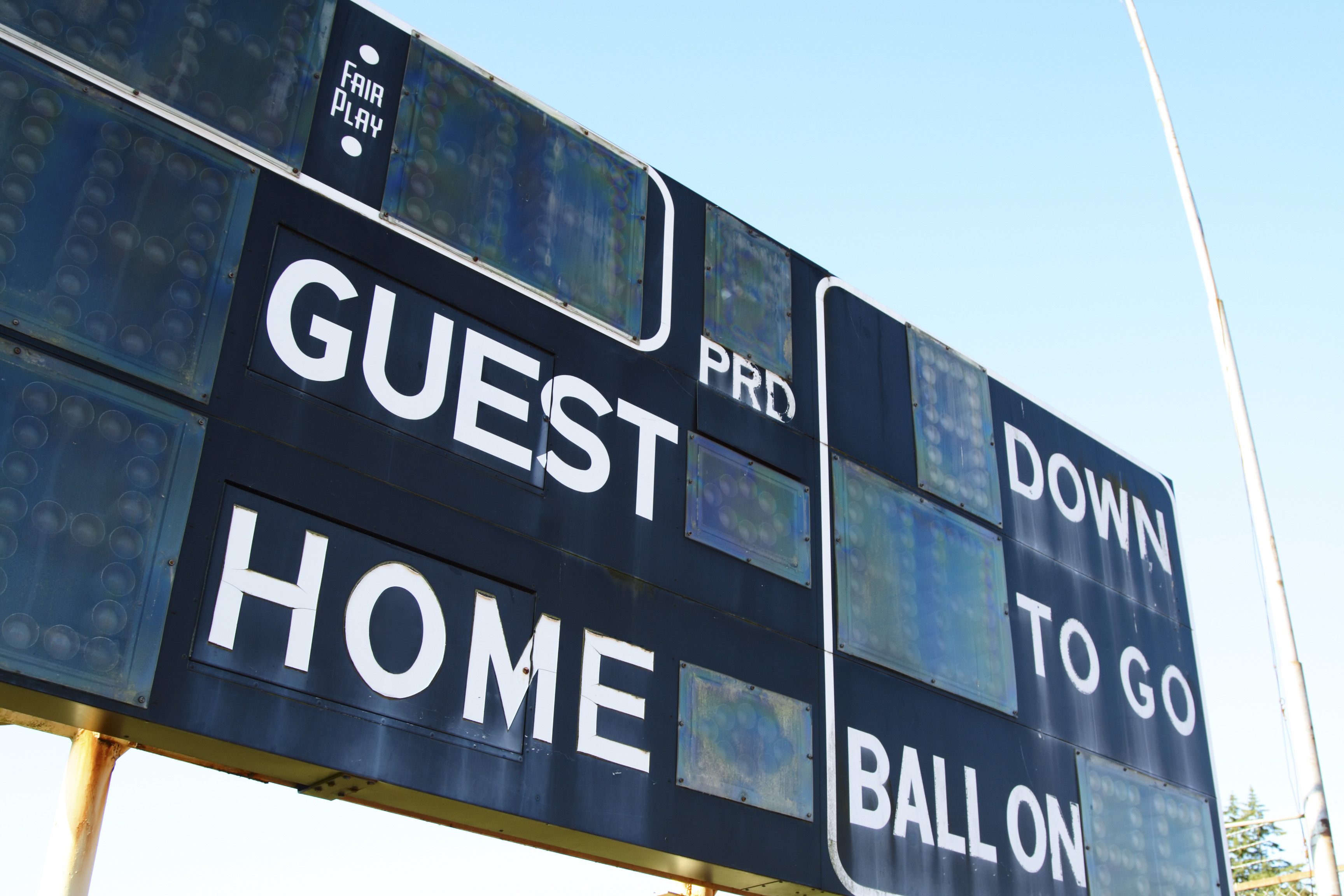 A shot of a score board on a football stadium